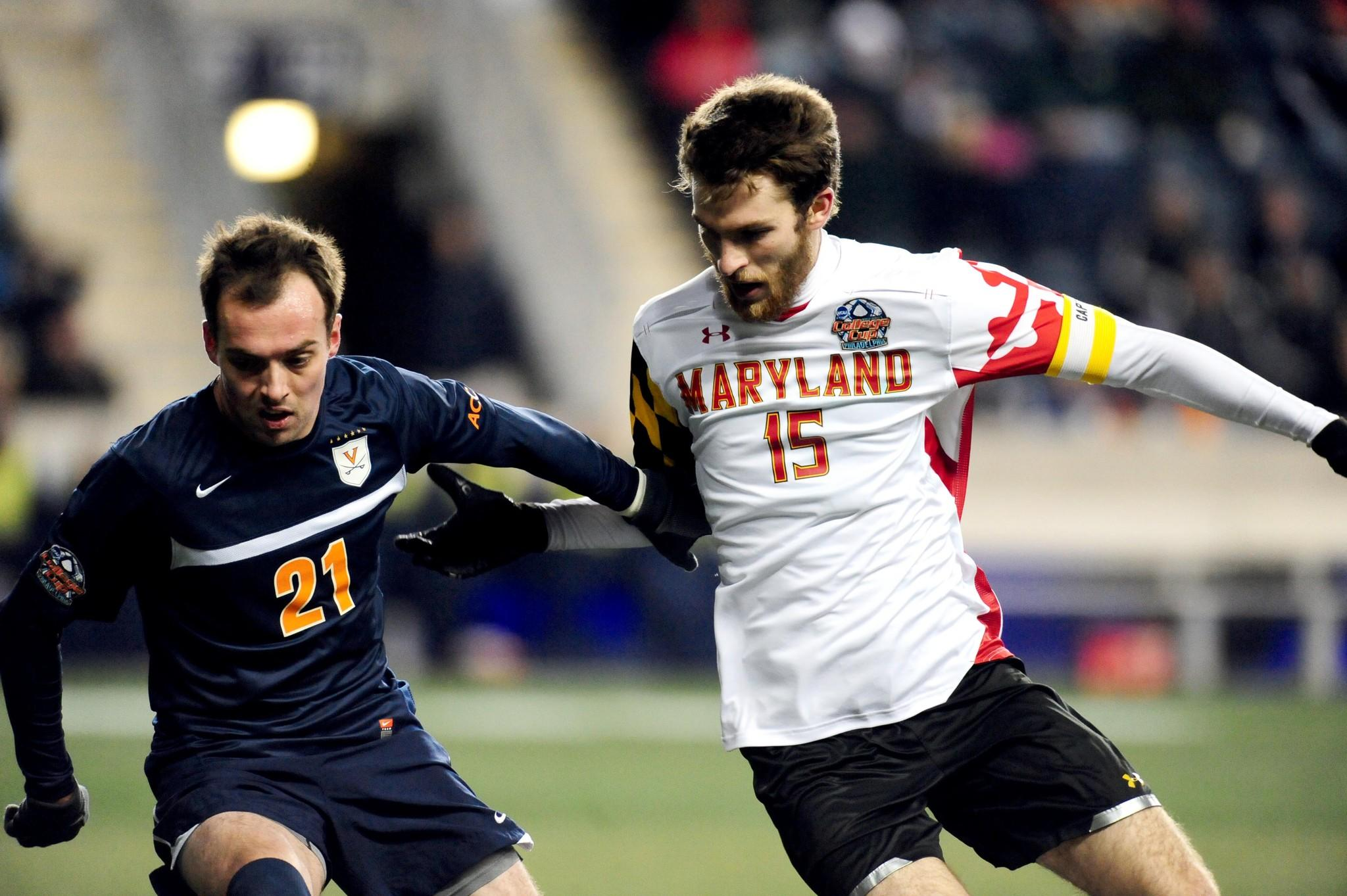 Dec 13, 2013; Chester, PA, USA; Maryland Terrapins forward Patrick Mullins (15) fights for a ball with Virginia Cavaliers forward Ryan Zinkham (21) at PPL Park. Mandatory Credit: Evan Habeeb-USA TODAY Sports