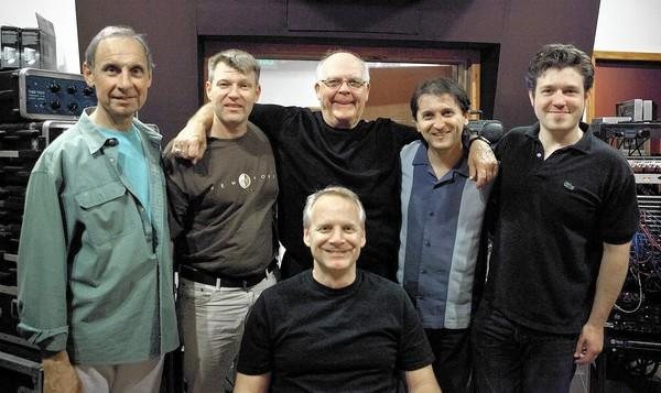 Bill Coté, center, surrounded by the musicians of the Tamir Hendelman (seated) trio set to perform Jan. 18 at the Bahia Corinthian Yacht Club in Corona del Mar.
