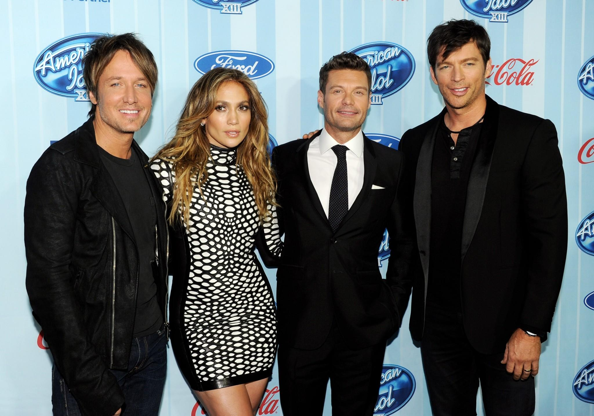 """American Idol"" judges Keith Urban, left, Jennifer Lopez and Harry Connick Jr., right, with host Ryan Seacrest."