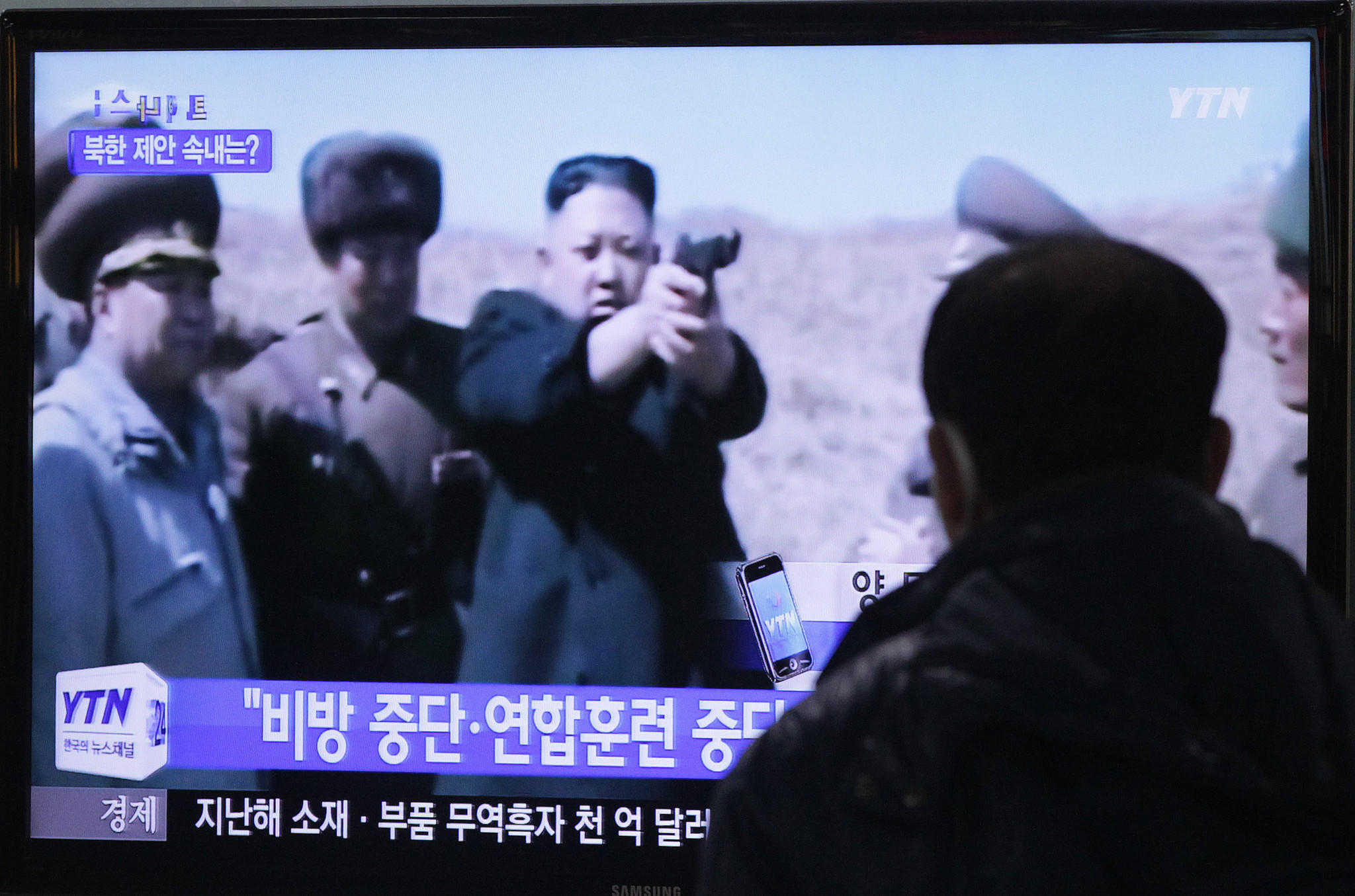 A television monitor at the Seoul Railway Station in the South Korean capital shows North Korean leader Kim Jong Un aiming a gun at an unknown target.