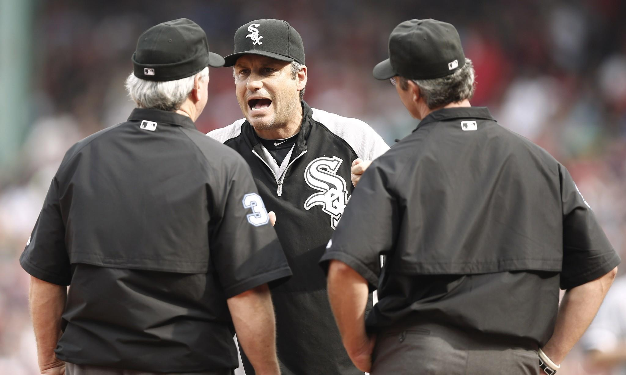 White Sox manager Robin Ventura argues with umpire Dana DeMuth #32, left, and umpire Paul Nauert #39 about a close play at third.