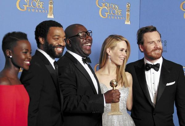 """12 Years a Slave"" director Steve McQueen, center, and cast after winning Best Motion Picture - Drama at the 71st annual Golden Globe Awards on Jan. 12. Life   Arts Editor Michael Miller predicts ""Slave"" will also win Best Picture at the Academy Awards."