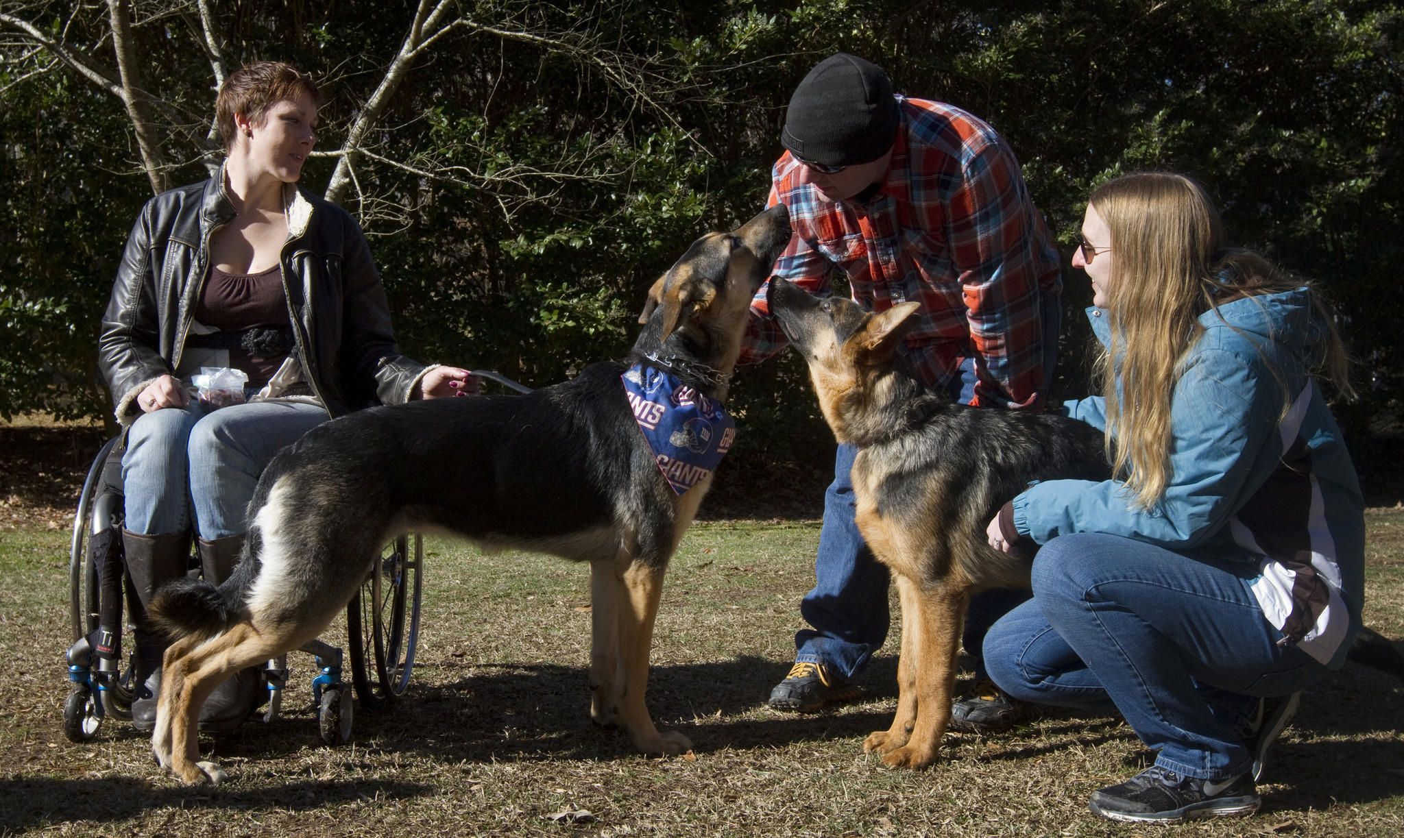 (From left) Laurie Wood, Joshua George and Olivia George watch as German Shepherds Squatch and Anubis meet each other at Citizens K9 Training and Agility in Chesapeake on Jan. 9.