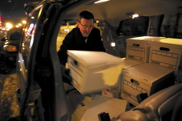 Greg Brown joins other members of First Presbyterian Church of River Forest in delivering books Wednesday in honor of Anne Smedinghoff, a U.S. diplomat who was killed last April in Afghanistan, to New Moms Inc.