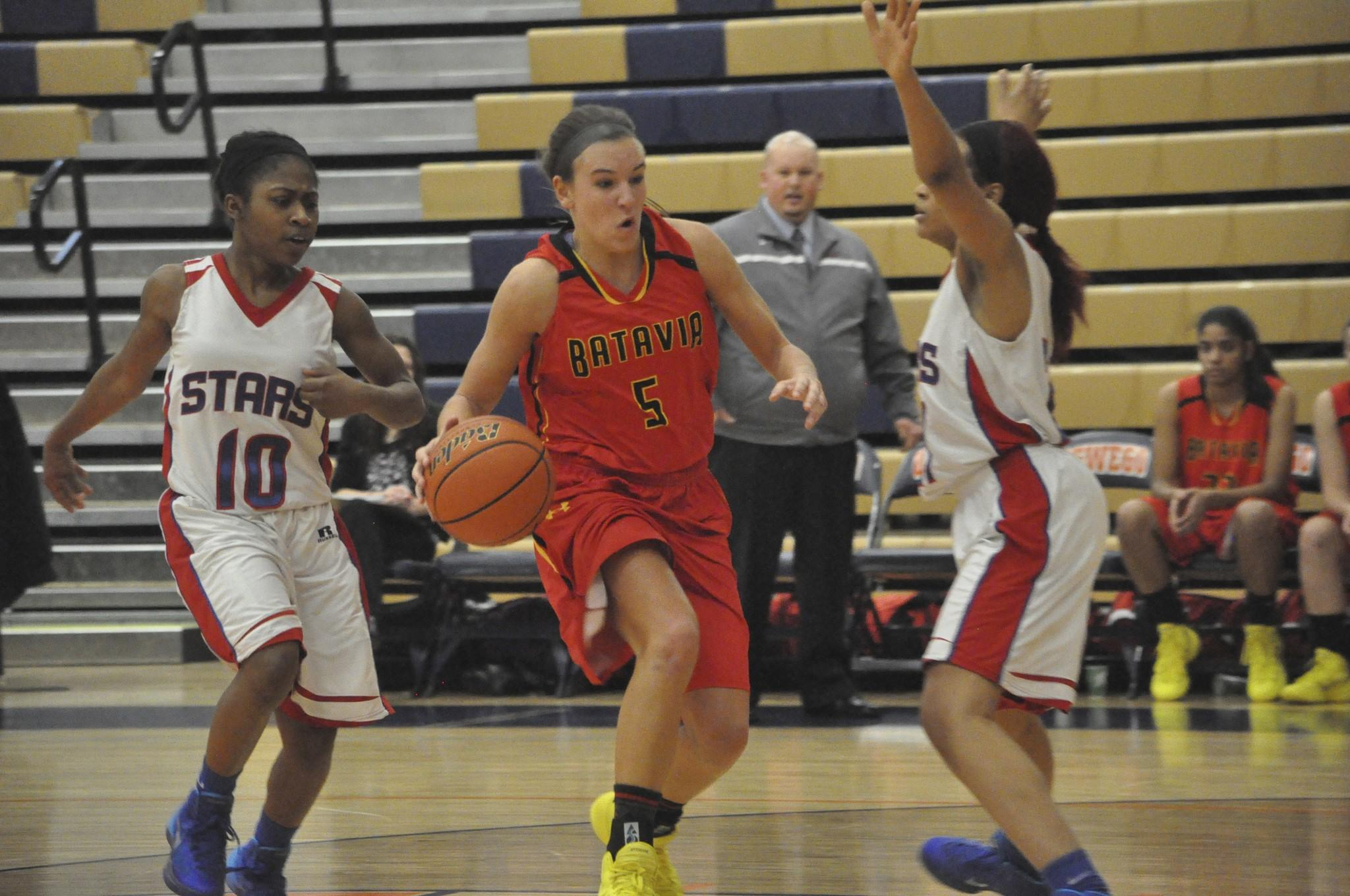 Batavia's Liza Freundt (5) drives between Rich South defenders on Dec. 21. The win gave Batavia third place at Oswego's Hoops for Troops tournament.