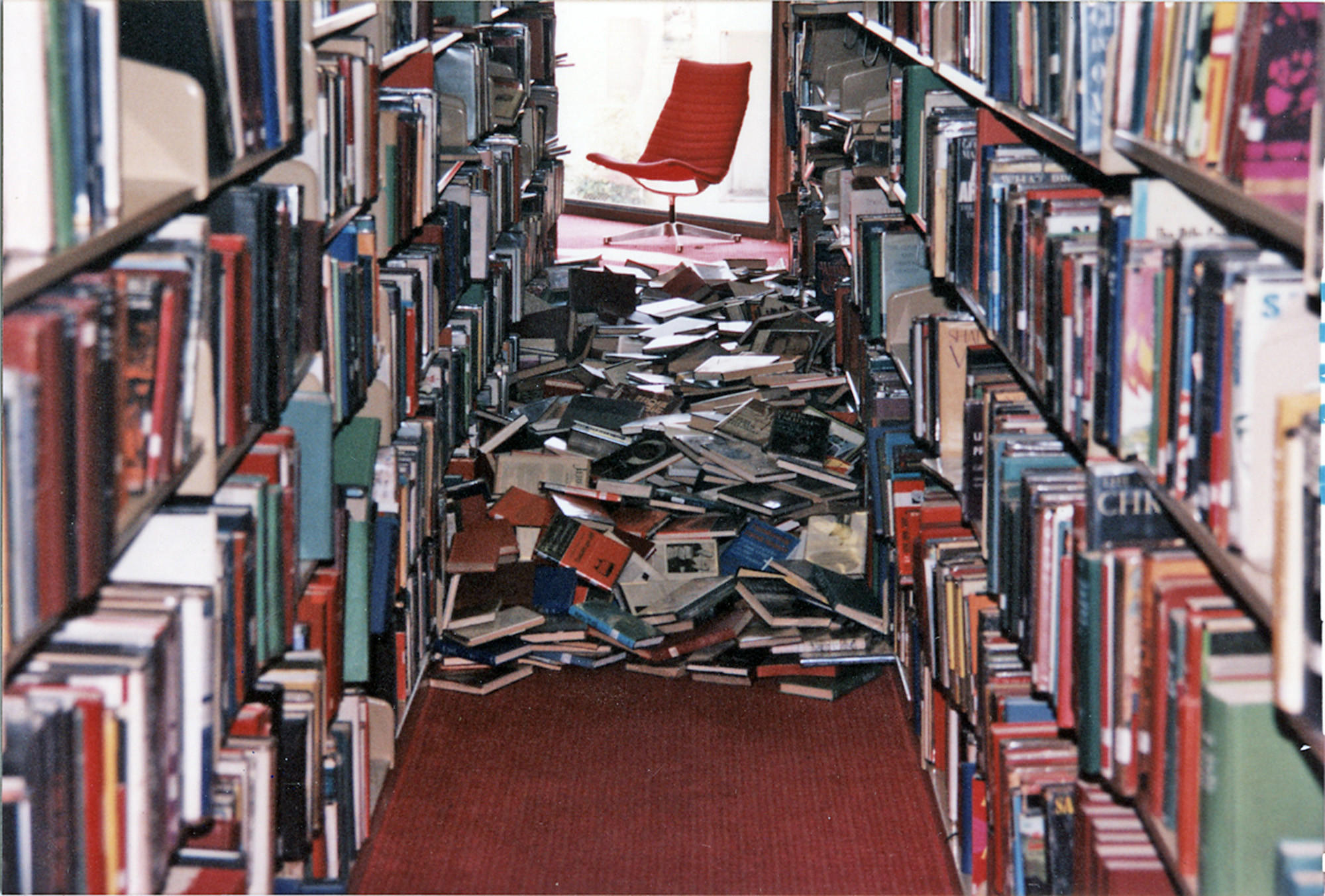 Books knocked off the Glendale Central Library shelves lie of the floor after the 1994 Northridge earthquake.