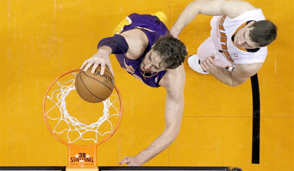 Pau Gasol dunks the ball in front of Phoenix guard Goran Dragic the Lakers' loss Wednesday to the Suns, 121-114.