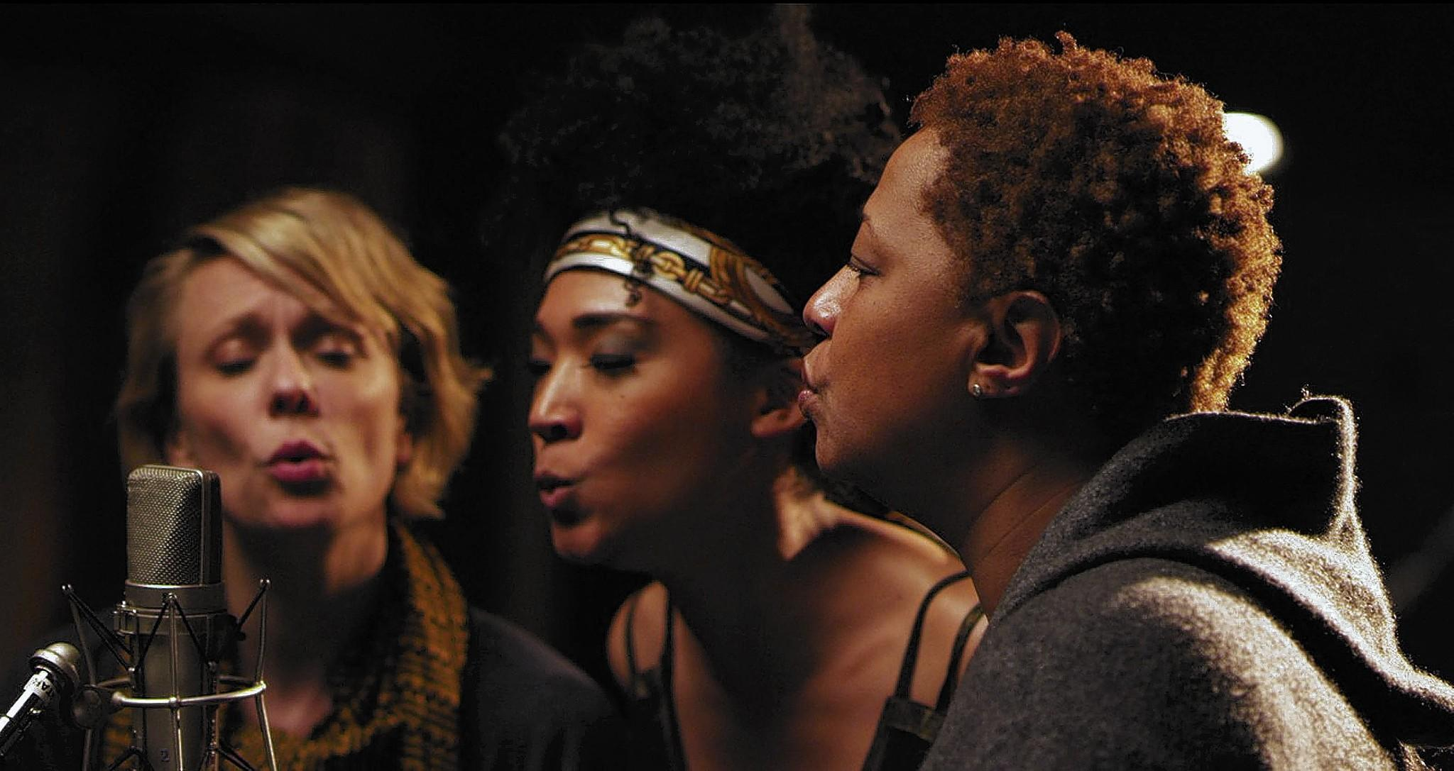"Jo Lawry, left, Judith Hill and Lisa Fischer sing ""Lean on Me"" in ""20 Feet From Stardom."""
