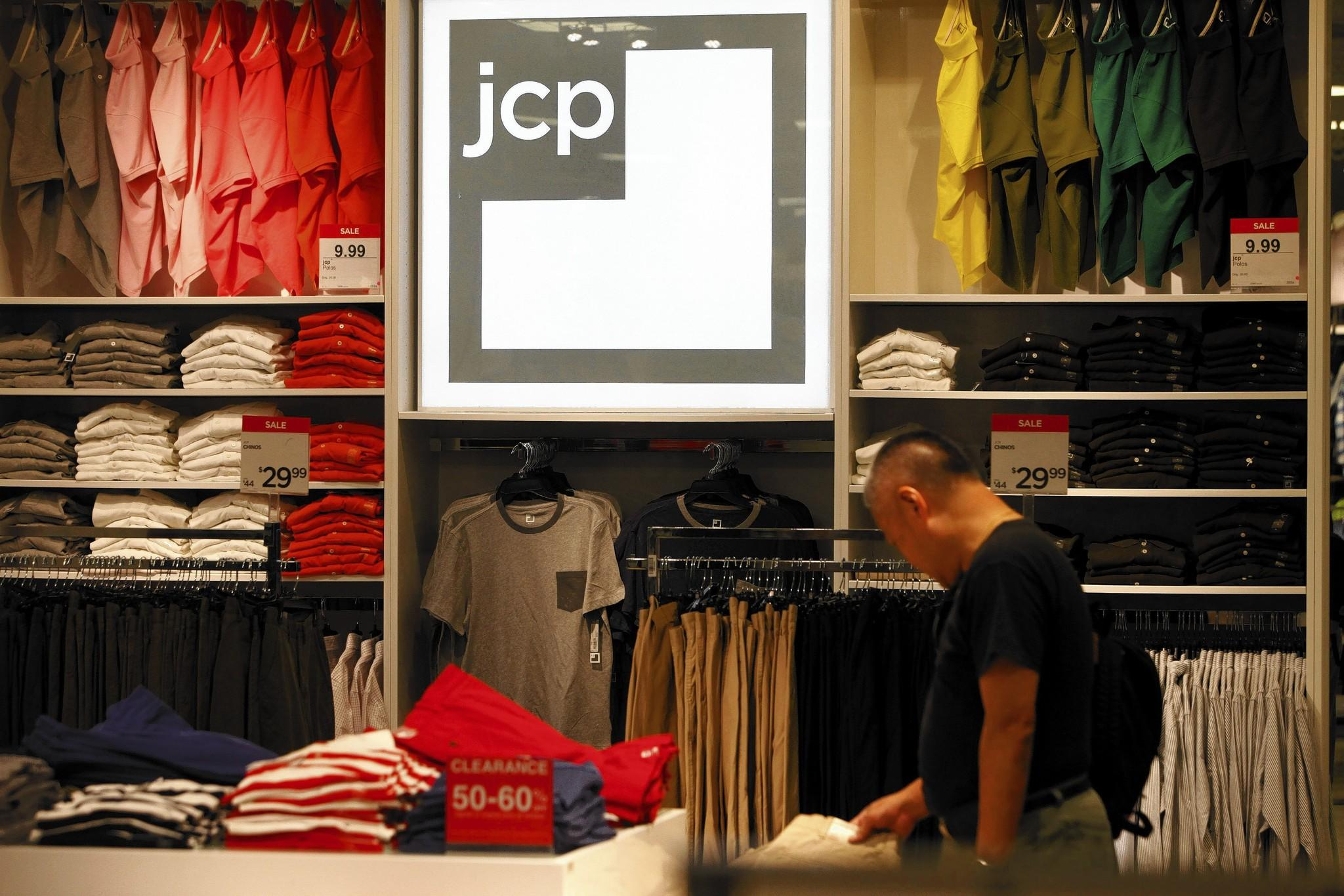 A man looks at clothing in a J.C. Penney store at the Glendale Galleria shopping center.