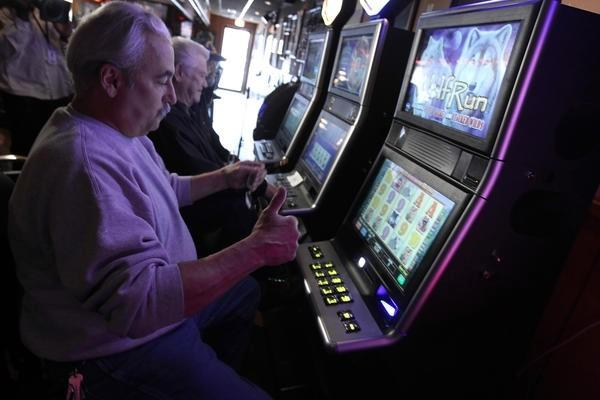 Dan Accardo plays video poker at Crabby's Pub in Stickney as the game went online in Illinois.