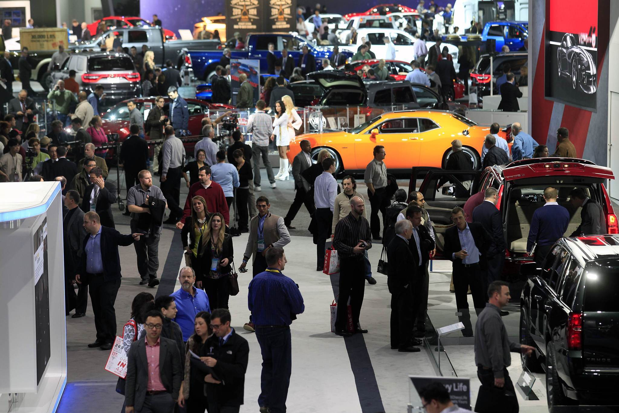 Visitors attend the North American International Auto Show in Detroit.