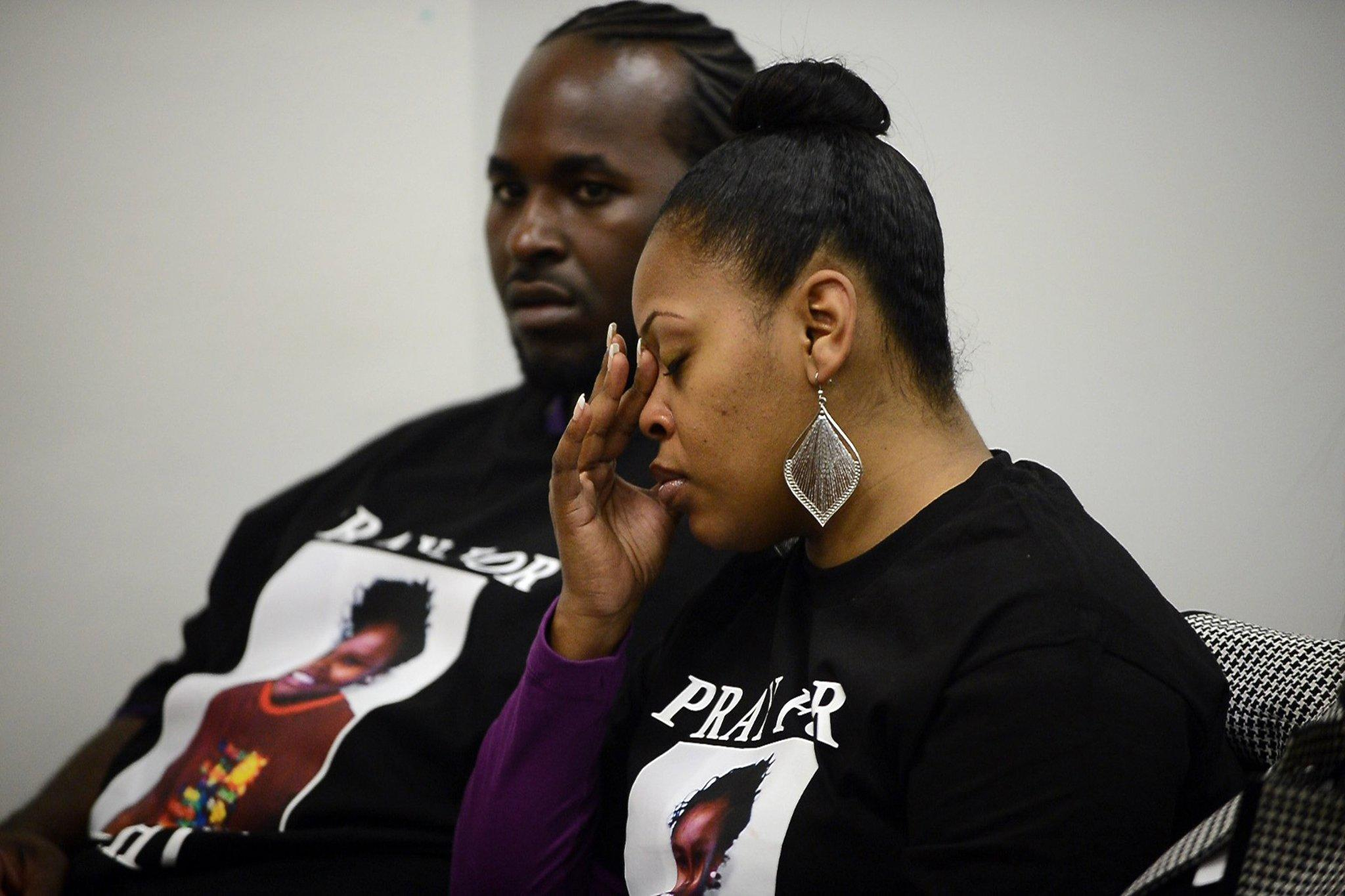 Nailah Winkfield, mother of Jahi McMath, sits with her husband, Martin Winkfield, left, while attending a court hearing to discuss the treatment of 13-year-old daughter Jahi McMath.