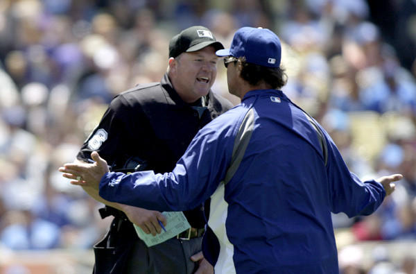 MLB officials believe expanded use of instant replays could result in shorter games because there should be fewer arguments and protests, such as the one above between Dodgers Manager Don Mattingly and umpire Ron Kulpa.