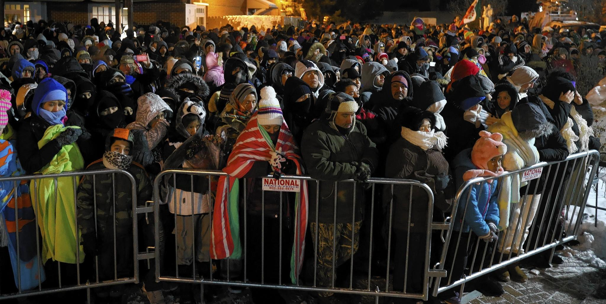 The faithful attend a Des Plaines celebration of Our Lady of Guadalupe in December. Police billed $30,000 for security.