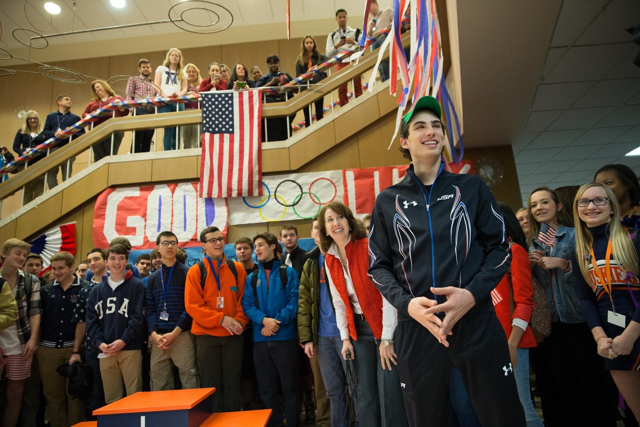 Olympic speedskater Emery Lehman reacts to the crowd during a send-off event held in the lobby of Oak Park-River Forest High School on Friday.