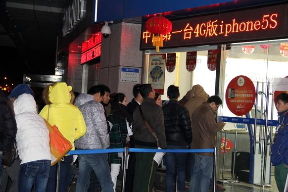 Customers line up before dawn to buy Apple iPhones on the first day they go on sale at a China Mobile outlet in Nanjing, in eastern China's Jiangsu province.
