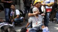Anti-government protests in Thailand turn violent with explosion