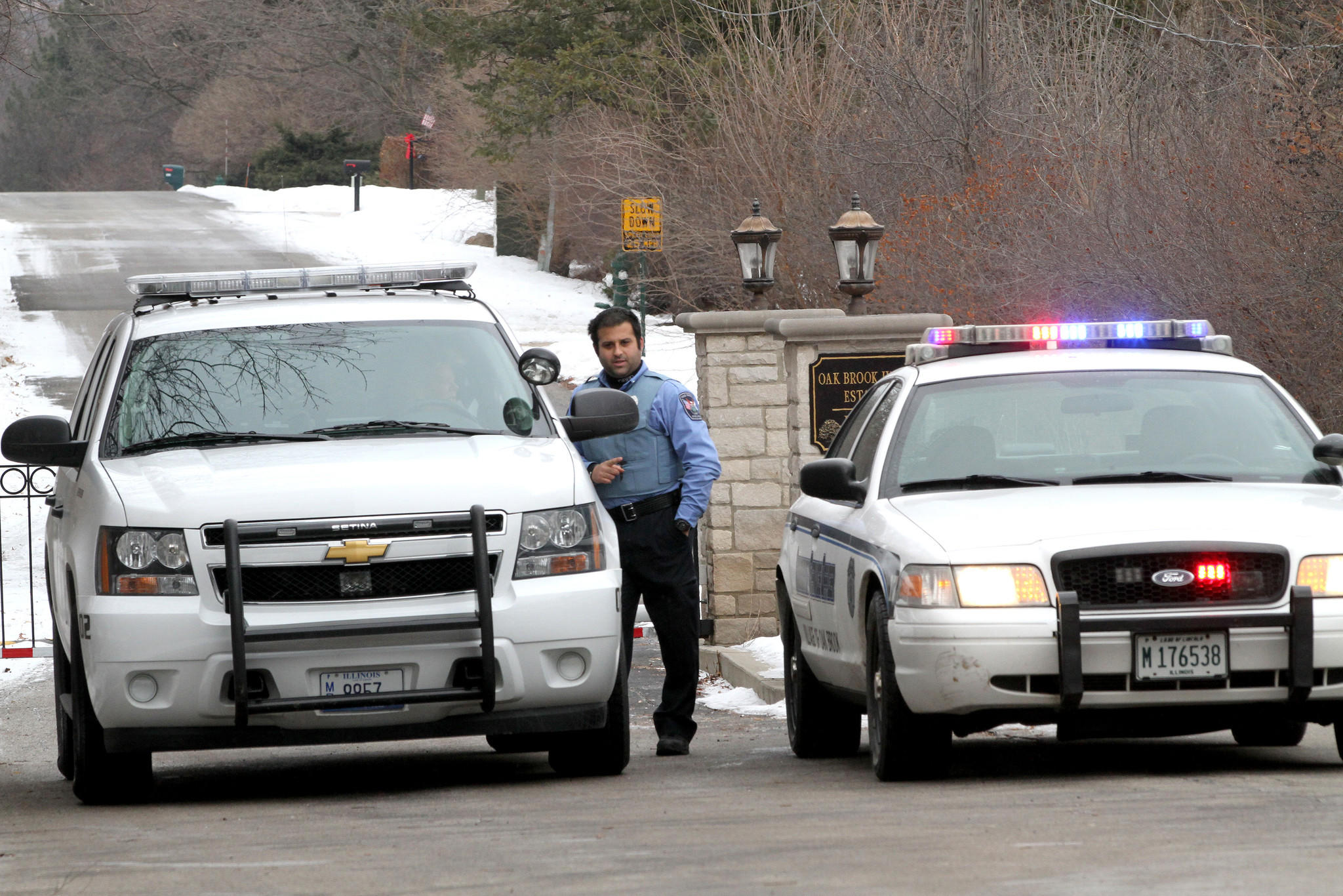 Oak Brook police block access to Oak Brook Hills Estates after one person died and seven were injured from an apparent carbon monoxide poisoning at a residence.