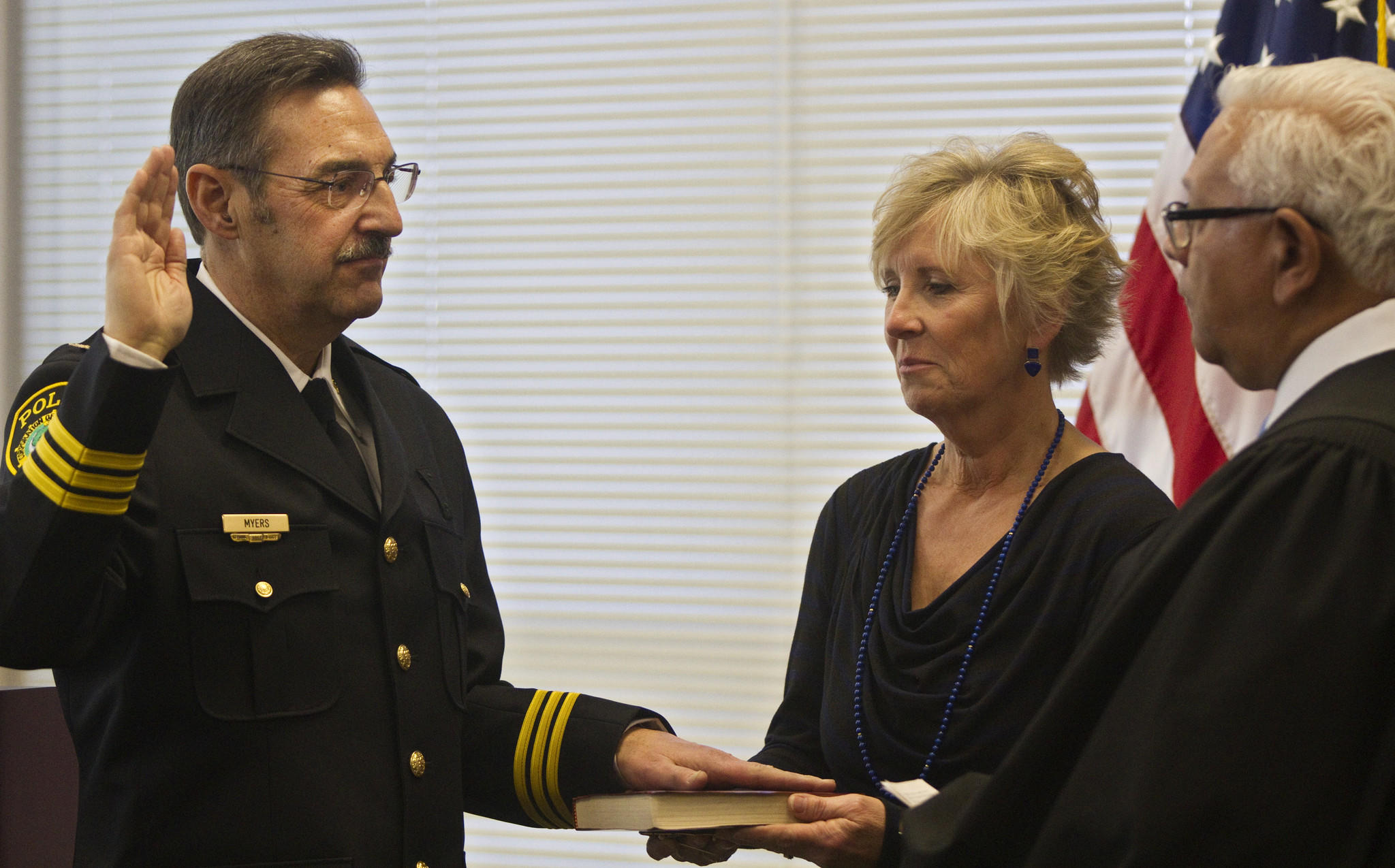 Newport News Chief of Police Richard W. Myers is sworn in by Judge David F. Pugh while his wife, Cindy Myers, looks on during a ceremony at police headquarters on Friday.