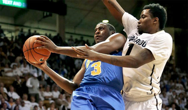 Jordan Adams eyes the basket as Colorado's Wesley Gordon defends during the first half of UCLA's 69-56 victory Thursday over the Buffaloes.