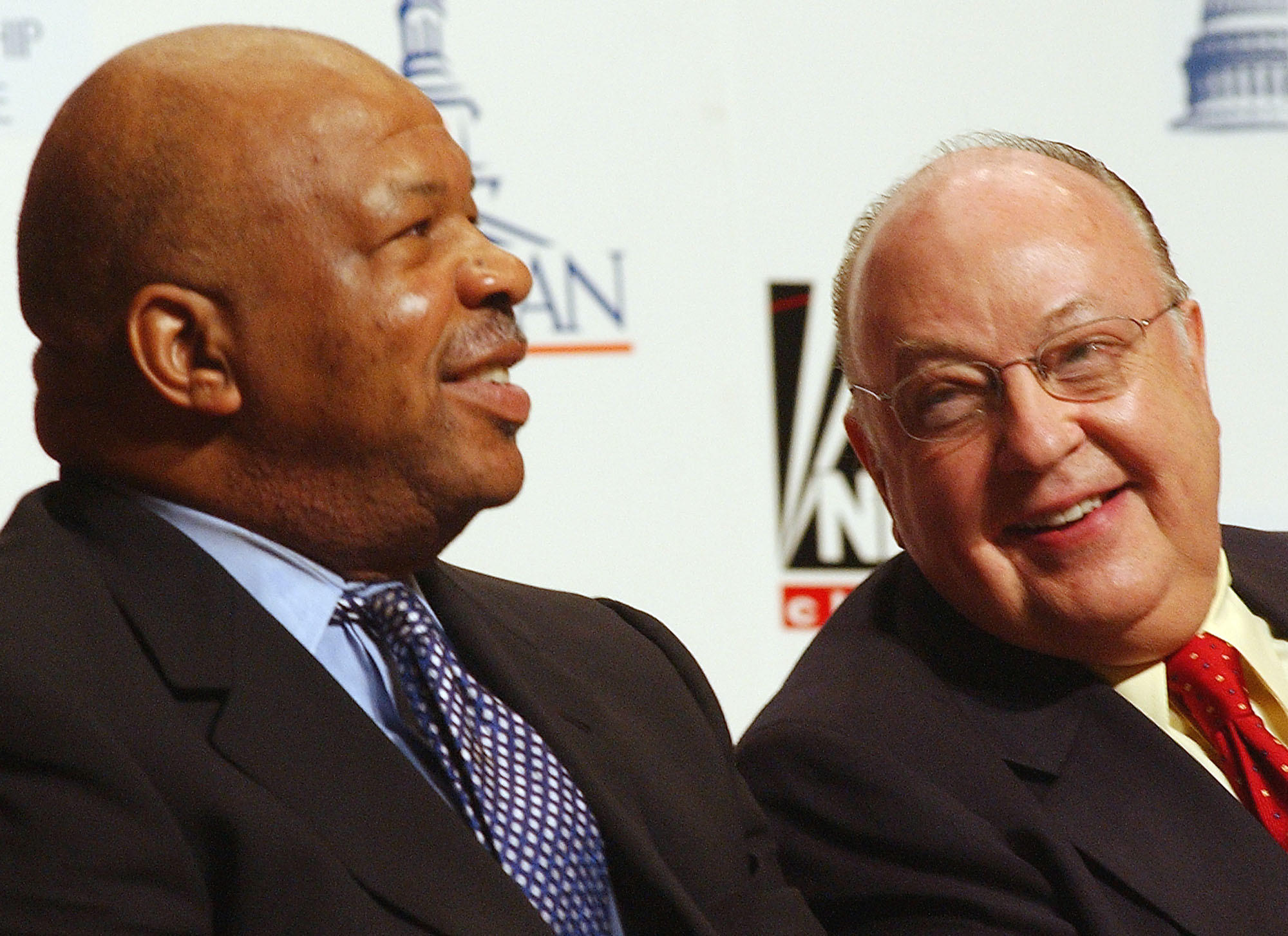 Chairman and CEO of Fox News Channel Roger Ailes, right, smiles at Rep. Elijah E. Cummings, D-Md., during a news conference at Morgan State University, in Baltimore, Thursday, Aug. 7, 2003, where they announced that the Congressional Black Caucus will partner with Fox news to host two presidential debates.