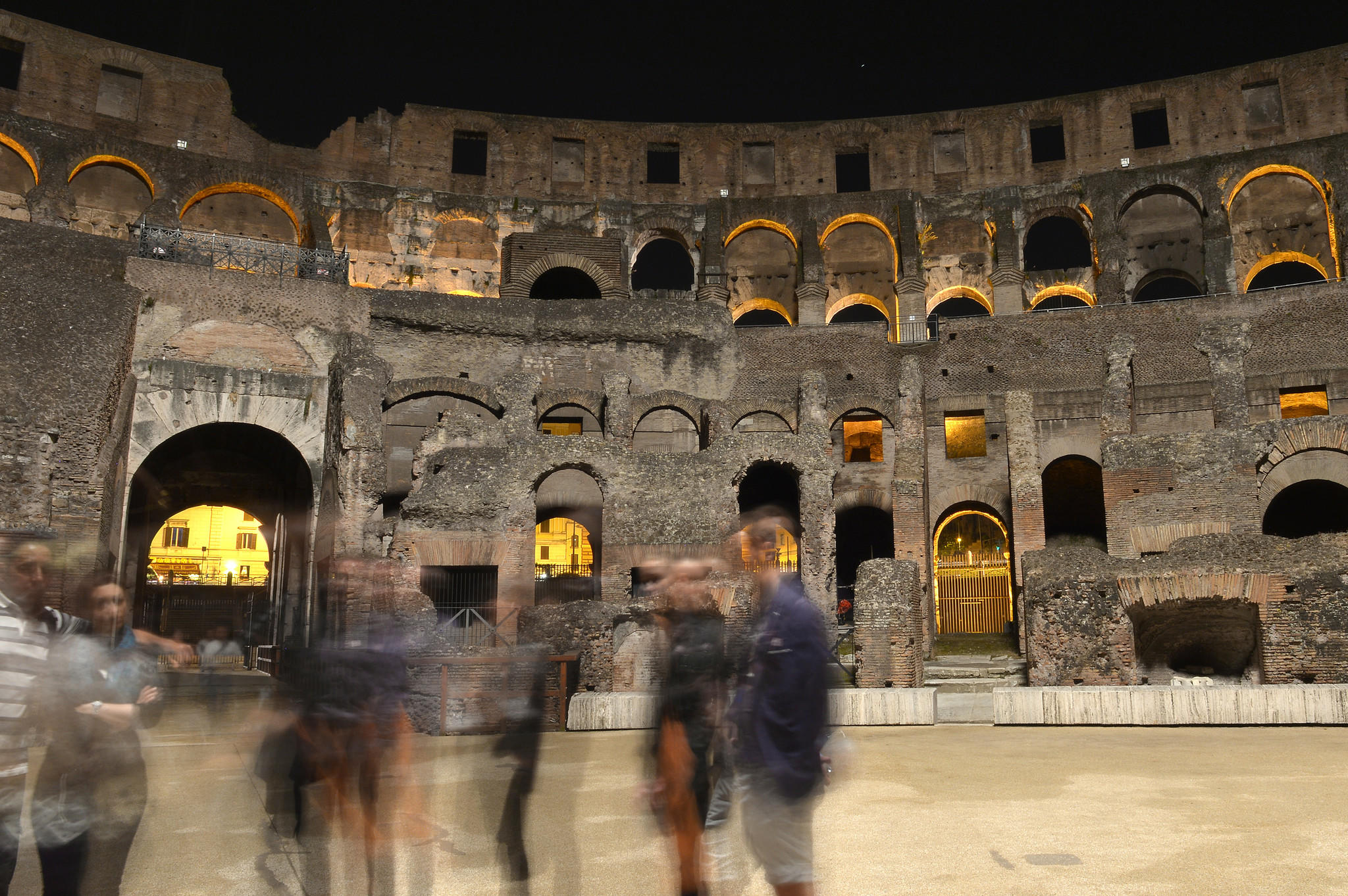 Visitors walk around the Colosseum in Rome. Functioning in groups requires compromise. In exchange for setting aside some of your needs and wants, you get to share novel experiences with your friends.