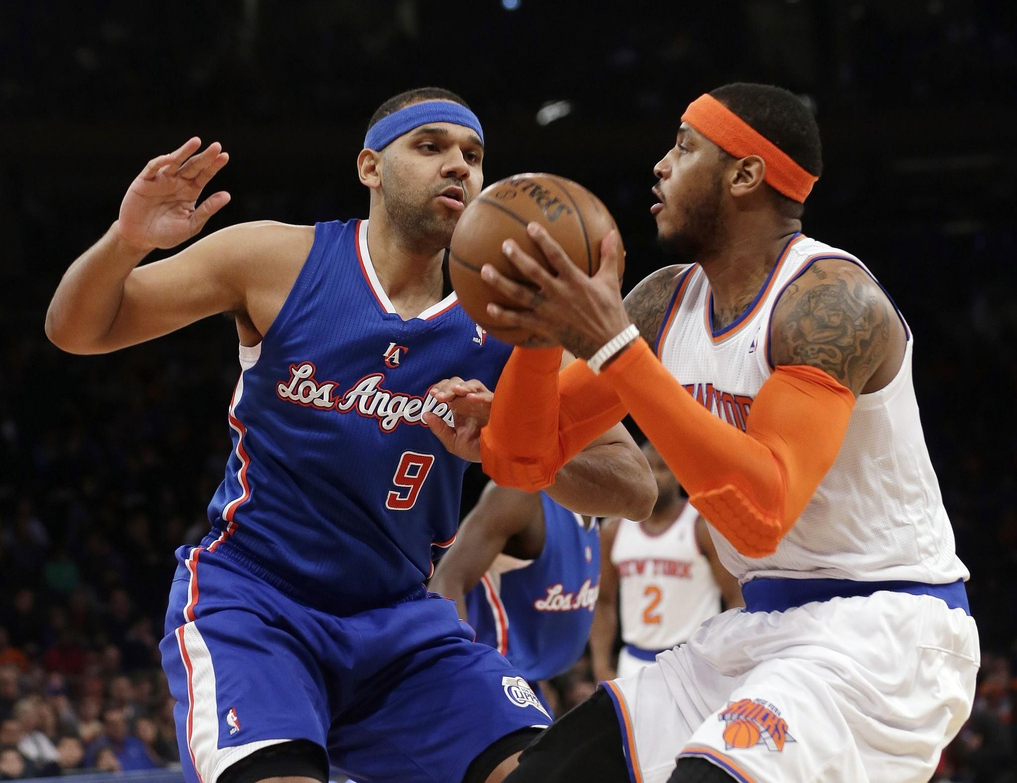 Jared Dudley guards New York's Carmelo Anthony during the first half of the Clippers' matchup with the Knicks on Friday at Madison Square Garden.