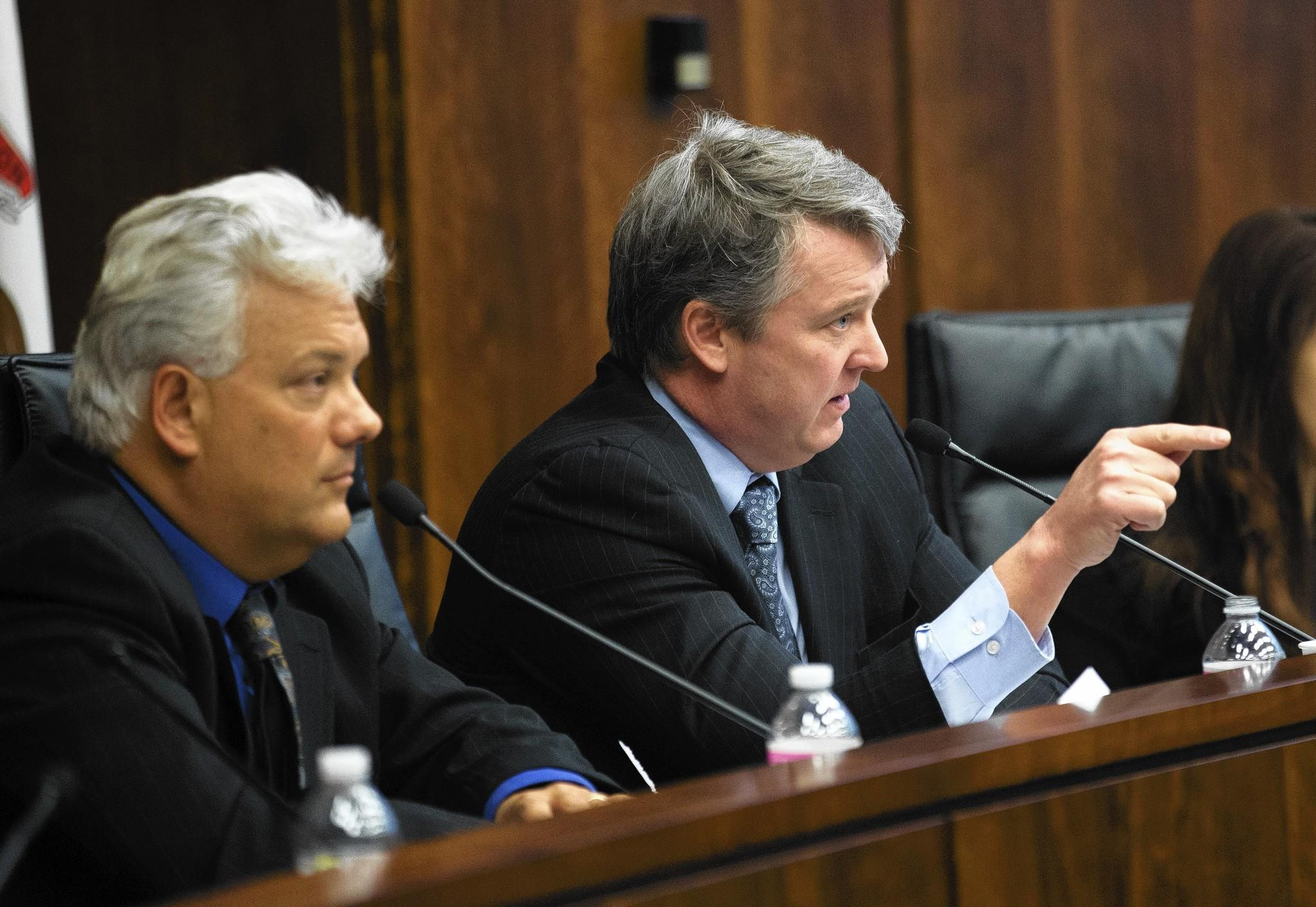 Reps. Jack Franks, D-Marengo, left, and John Bradley, D-Marion, discuss the future of economic incentives for businesses that locate in Illinois during a joint hearing Friday of the State Government Administration Committee and the Revenue and Finance Committee.