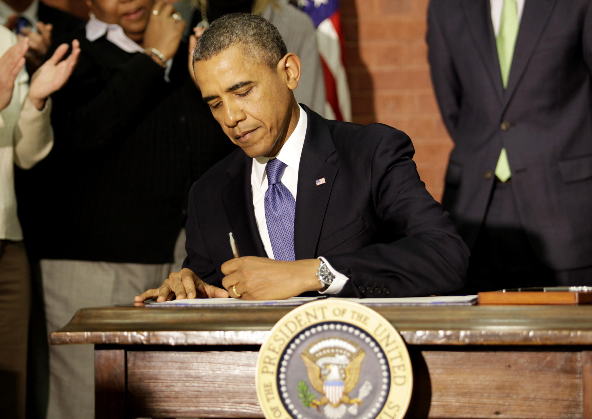 "President Barack Obama signs the ""Omnibus Spending Bill"" in Washington."
