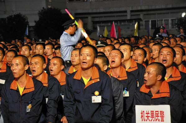 Inmates at a labor camp in Bajing, China, sing during a 2012 event celebrating the Communist Party's 18th National Congress.
