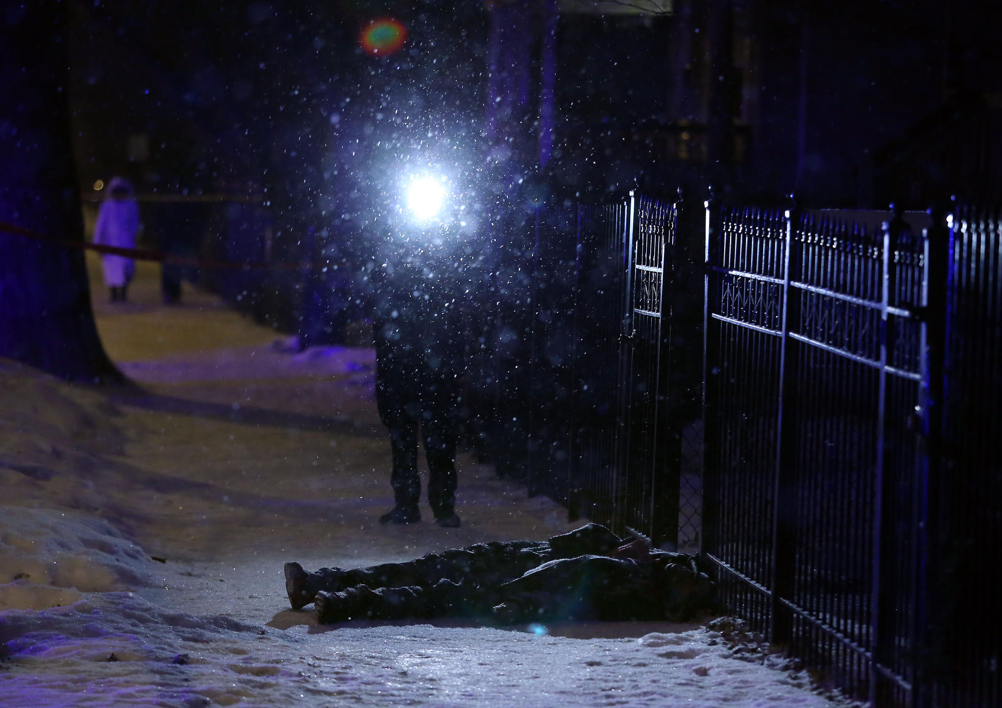 A Chicago police officer video records a dead body and the scene of the fatal shooting in the 4900 block of West Huron Street in the Austin neighborhood.
