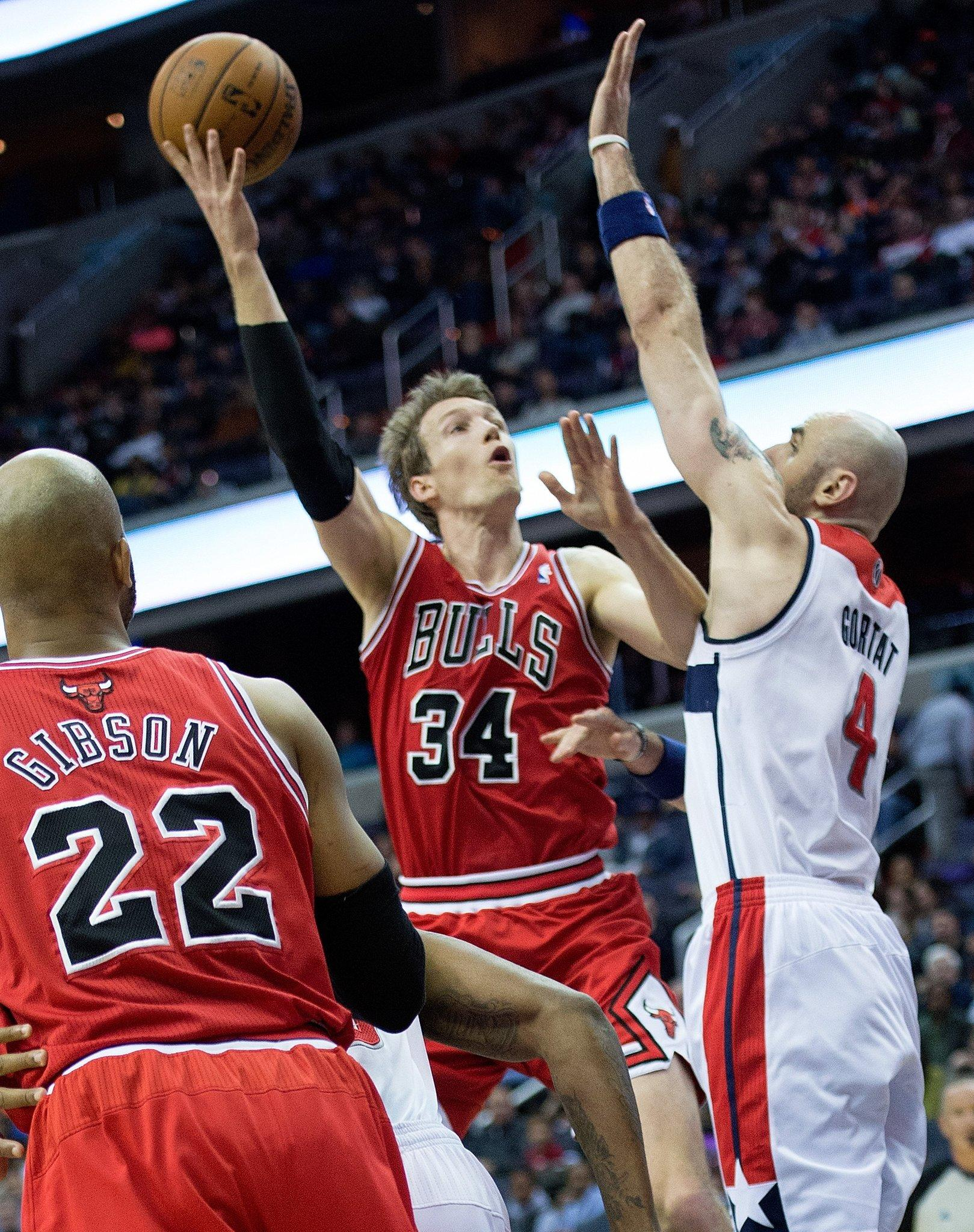 Chicago Bulls small forward Mike Dunleavy (34) scores against Washington Wizards center Marcin Gortat (4) during the first half of their game played at the Verizon Center.
