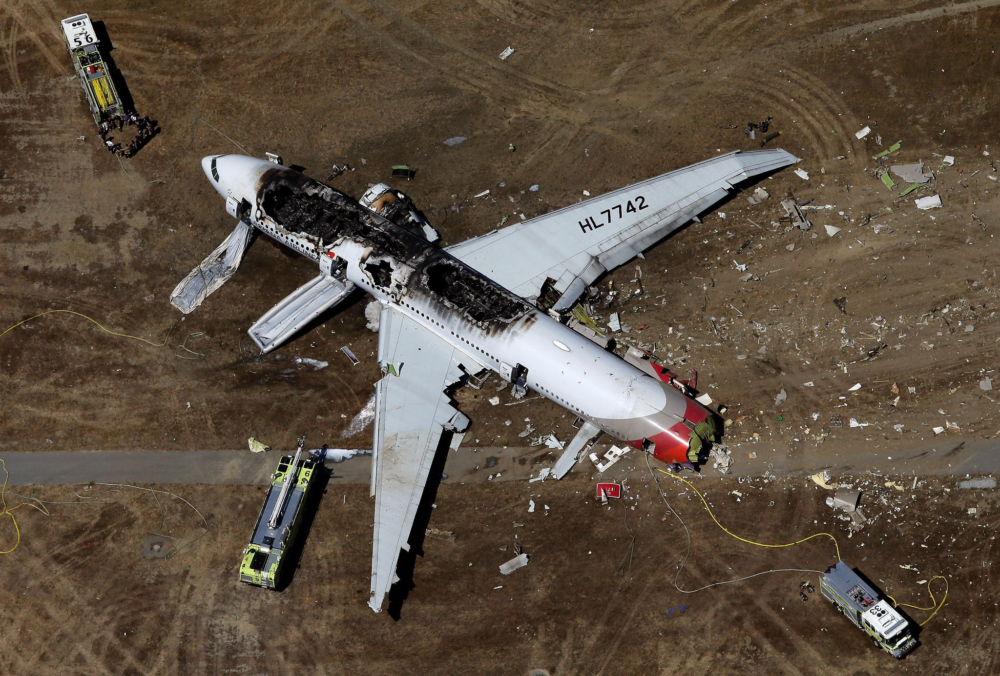 SAN FRANCISCO, CA - JULY 06: A Boeing 777 airplane lies burned on the runway after it crash landed at San Francisco International Airport July 6, 2013 in San Francisco, California.