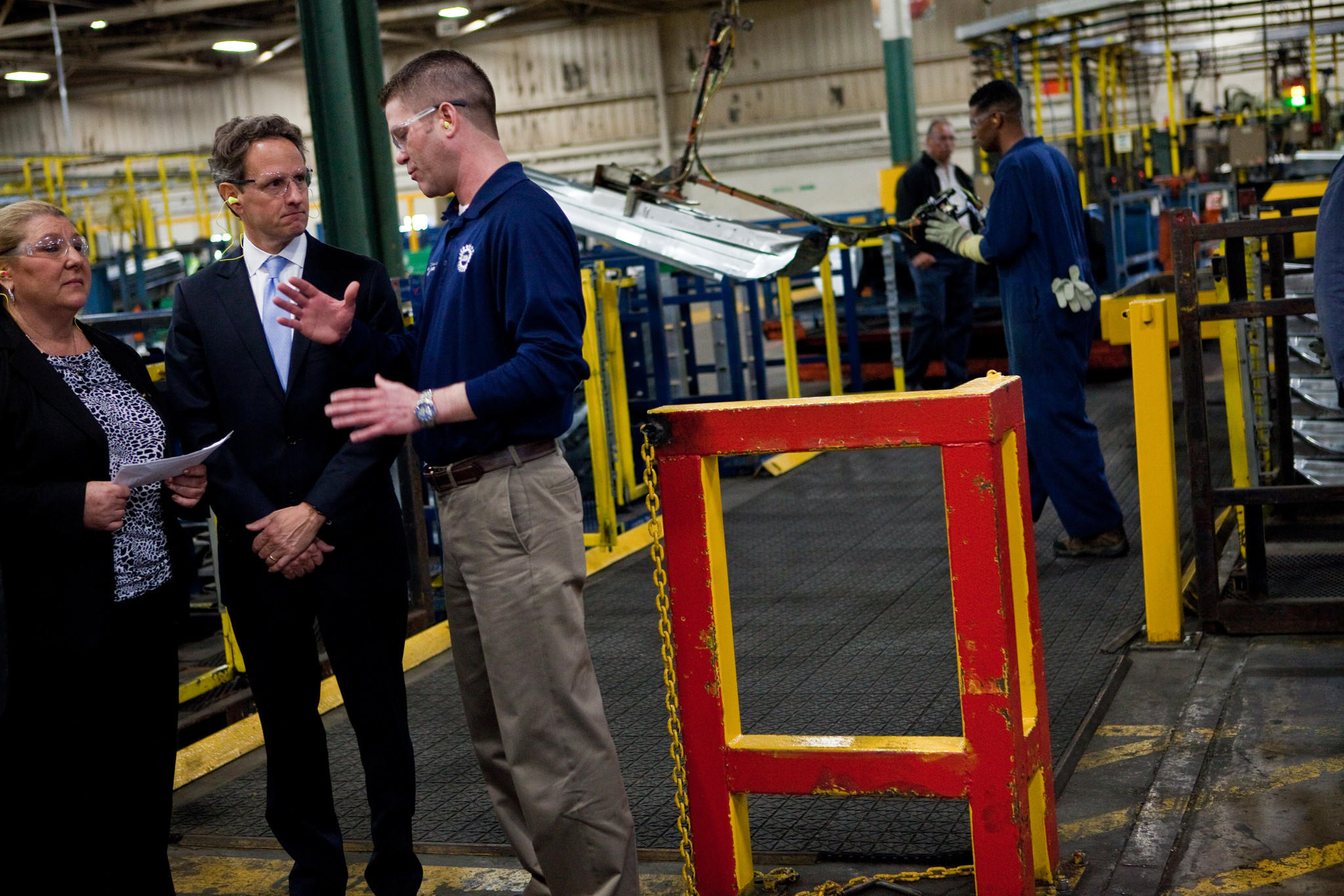 Treasury Secretary Tim Geithner talks to Matt Kolanowski, UAW Local 588 President, right, as he tours the Ford Motor Companys Chicago Stamping Plant in Chicago Heights with Plant Manager Gloria Georger, left, on Wednesday, April 4, 2012.