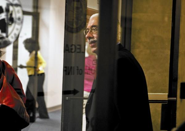 Cook County Assessor Joseph Berrios walks to his office after announcing the formation of a Mortgage Foreclosure Surplus Fund Task Force at a press conference in Chicago on Thursday, August 25, 2011.