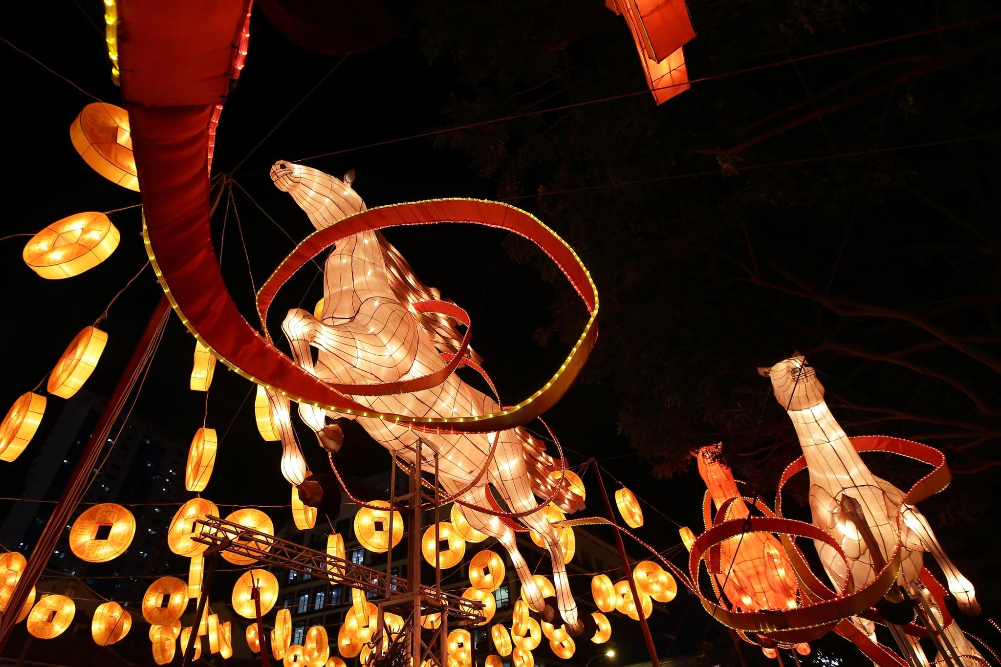 Life-size horses shaped lanterns and 'floating' gold coins adorn the streets of Chinatown on January 11, 2014 in Singapore. On January 31st, people around the world will welcome the Year of the Horse, one of the most anticipated holidays of the Chinese calendar. Also known as the Spring festival or the Lunar New Year, the celebrations last for about 15 days.