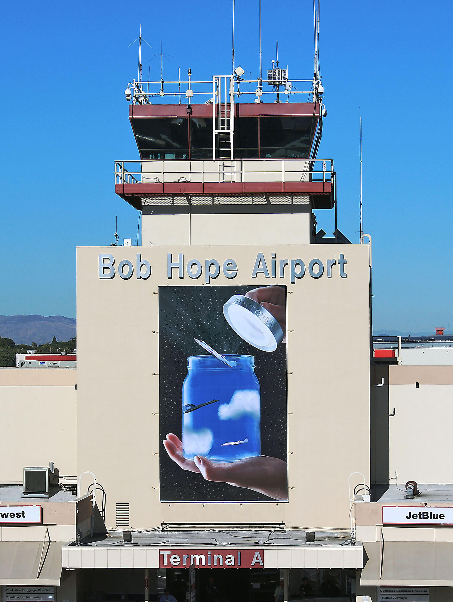 The first place art piece featured at the Bob Hope Airport traffic control tower was designed by Burroughs High School arts students Jordan Lopez, Melissa Alfaro, Shushanik Hovakimyan, Rachel Verharst, Daniel Kerkotchian, and Breanna French under the instruction of John Burroughs High School teacher Bonnie Burrow