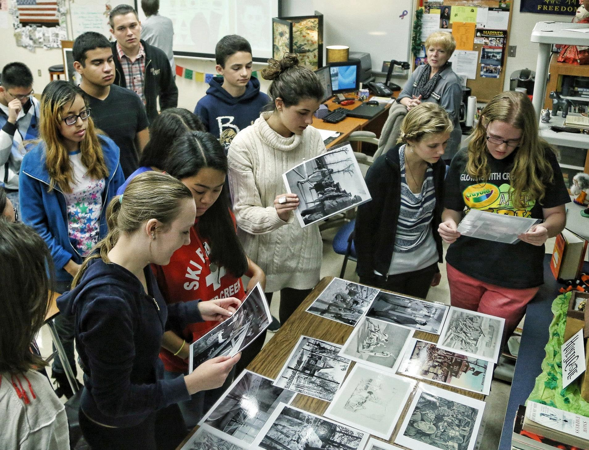 West Boca High students look at photographs of Holocaust victims who were imprisoned at the Buchenwald concentration camp in Germany. Visiting historian Jan Malecha who is a guide at the Buchenwald memorial will be visiting Palm Beach & Broward high schools over the next few months educating students about the death camp's history.
