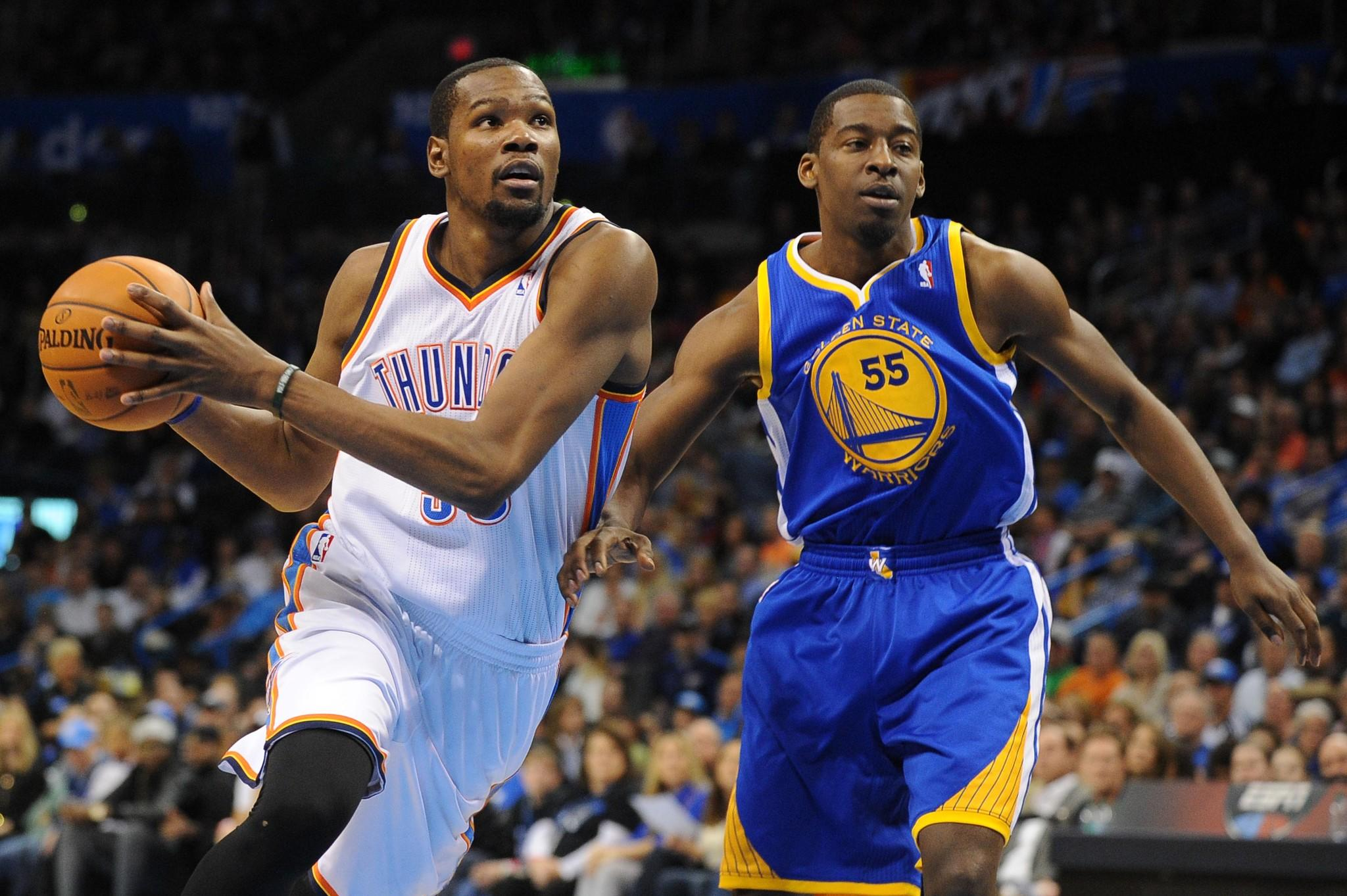 Oklahoma City Thunder small forward Kevin Durant (35) drives the ball to the basket against Golden State Warriors guard Jordan Crawford (55) at Chesapeake Energy Arena.