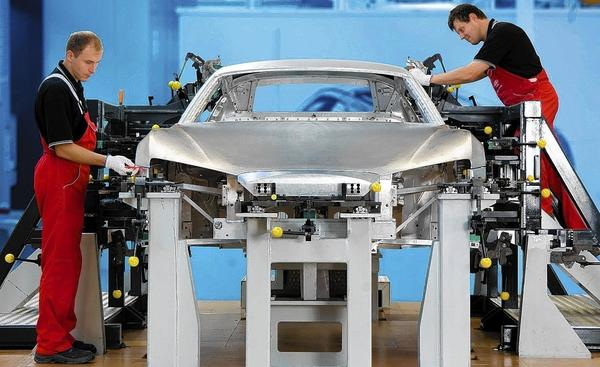 An aluminum-body Audi R8 is put together in Germany. Aluminum now is the second most used material in making cars.