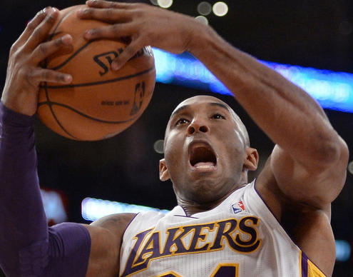 Kobe Bryant grabs a rebound against the Toronto Raptors on Dec. 8 in his first game back from a torn Achilles' tendon.