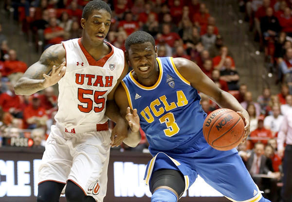 UCLA guard Jordan Adams (3) has his drive cut off by Utah guard Delon Wright in the second half Saturday.