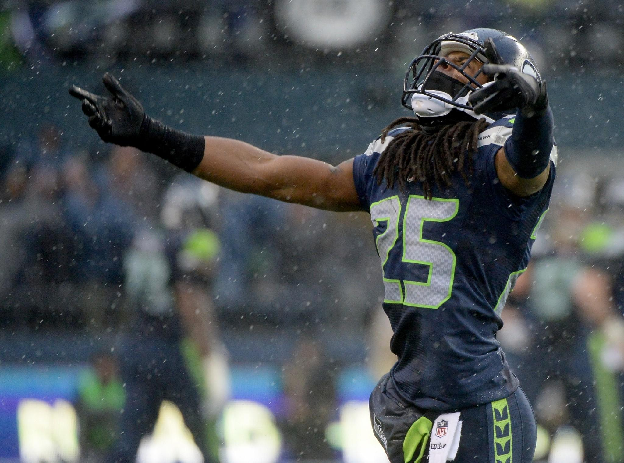 Cornerback Richard Sherman #25 of the Seattle Seahawks reacts in the second quarter while taking on the New Orleans Saints during the NFC Divisional Playoff Game at CenturyLink Field on January 11, 2014 in Seattle, Washington.
