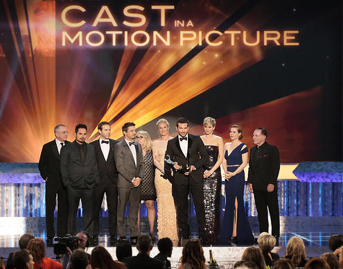 "The cast of ""American Hustle"" wins the award for motion picture. Bradley Cooper gives his praises for the film's director David O. Russell."