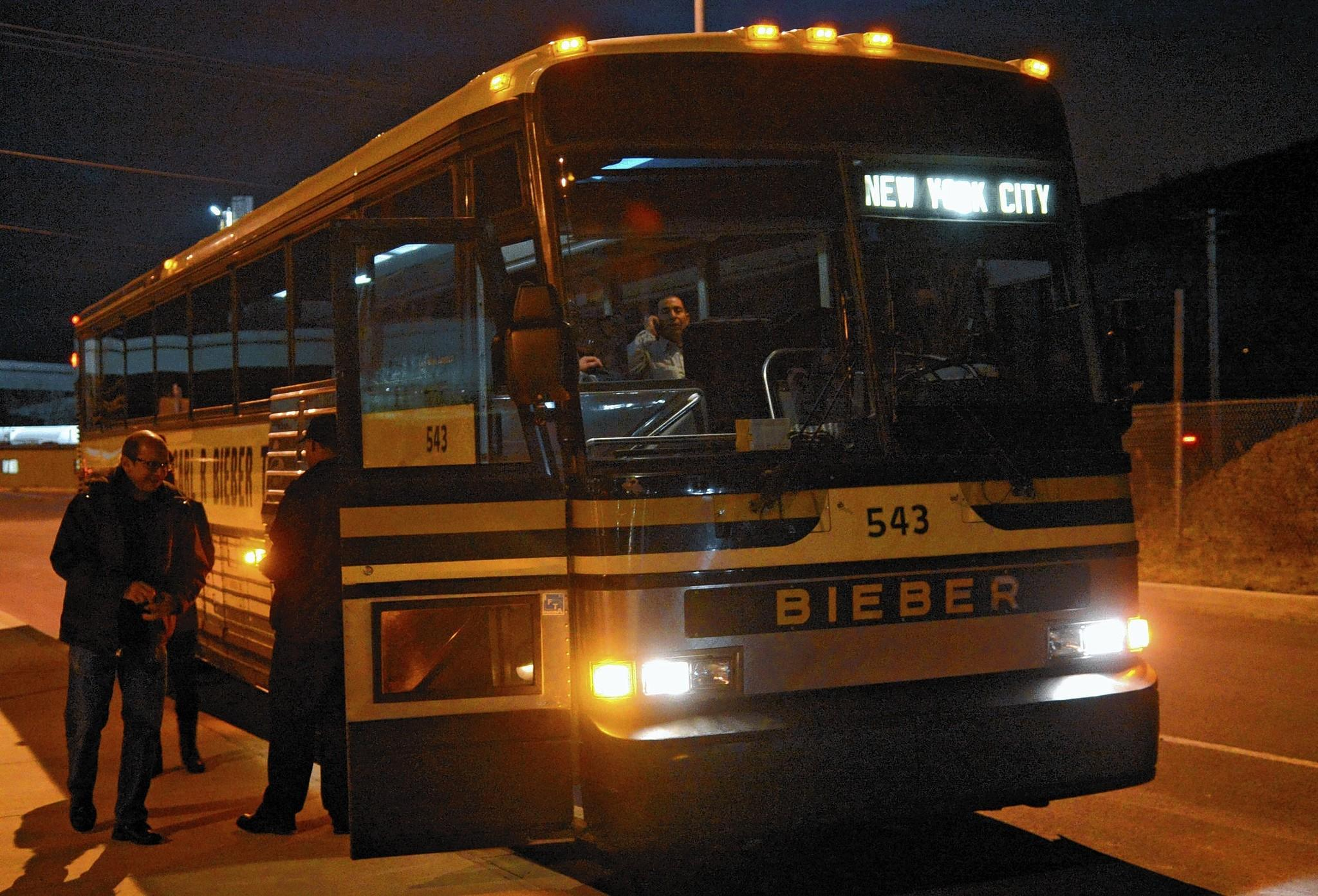 "Commuters board a Bieber bus to New York City near Hellertown. A Monroe County woman is studying any health effects of ""extreme"" commuting."