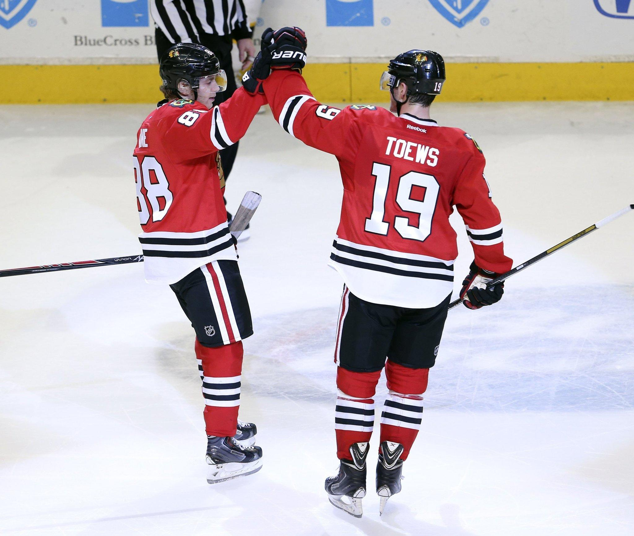 Chicago Blackhawks right wing Patrick Kane (88), left, celebrates with Blackhawks center Jonathan Toews (19) after his goal against the Boston Bruins during the shootout at the United Center in Chicago on Sunday, Jan. 19, 2014. The Blackhawks defeated the Bruins, 3-2.