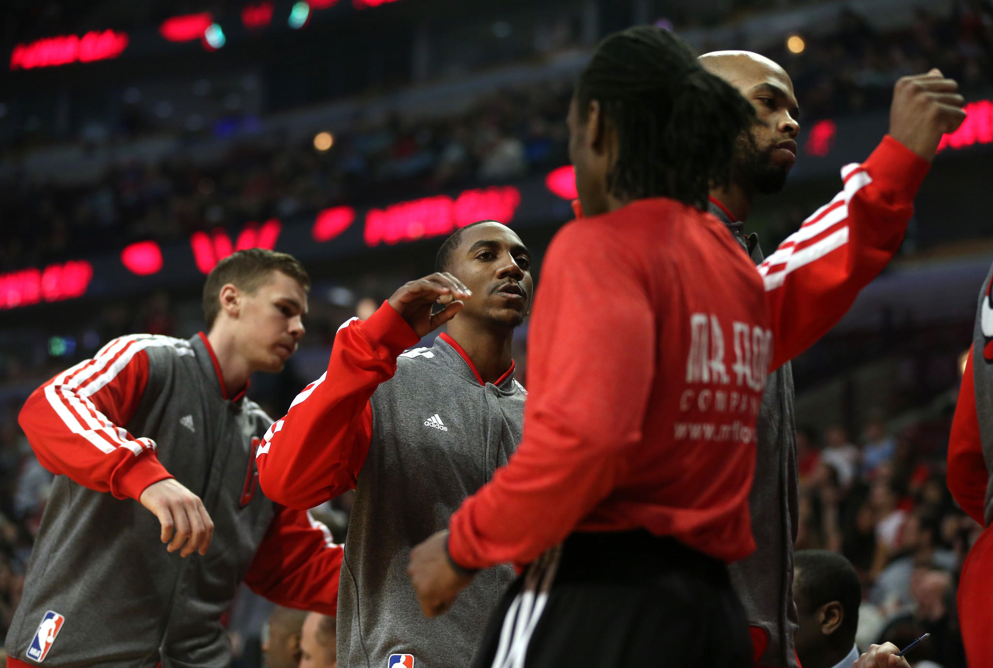 Chicago Bulls point guard Marquis Teague (center) walks to the bench before the start of a game at the United Center.
