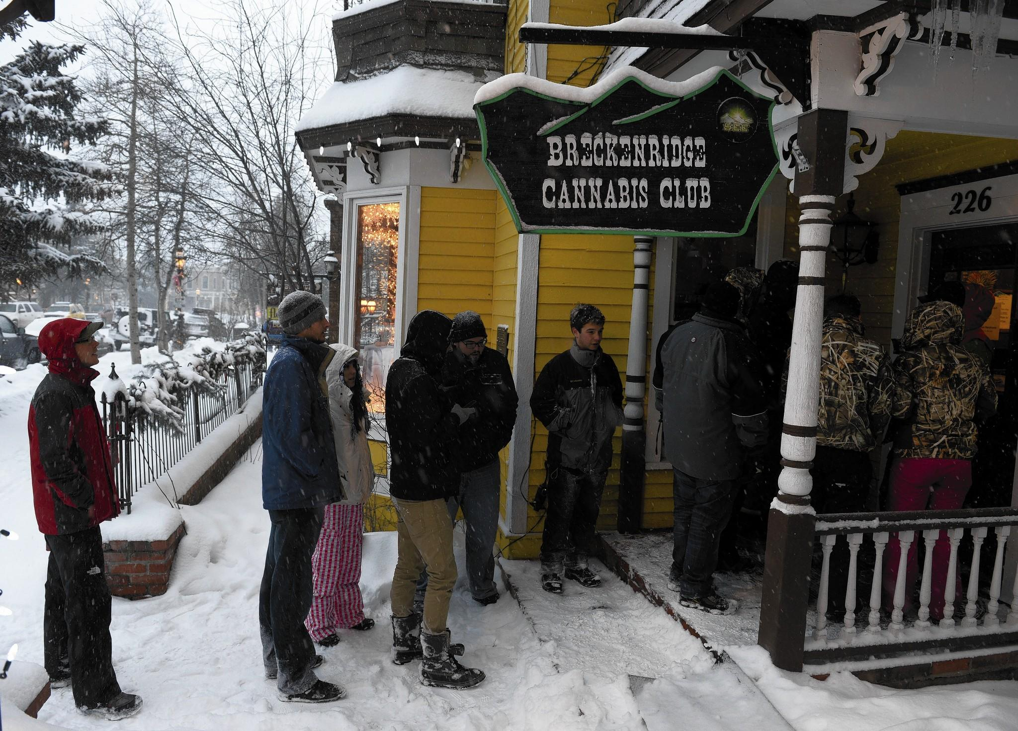 Customers line up outside a cannabis store on the morning of Jan. 1 in Breckenridge, Colo.