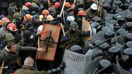 Ukraine demonstrators clash with riot police