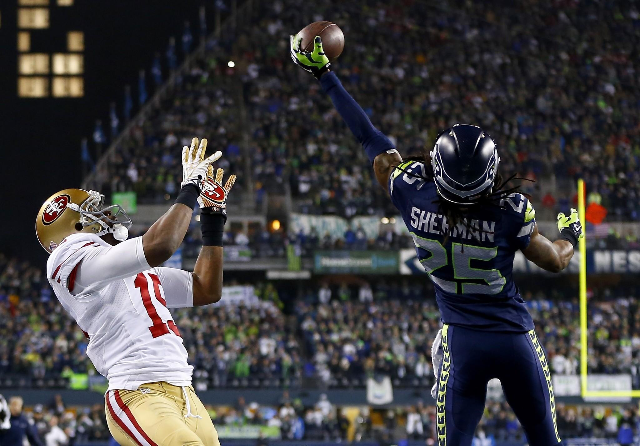 Seahawks cornerback Richard Sherman tips a pass in the end zone intended for 49ers receiver Michael Crabtree in the final minute of the NFC championship game.